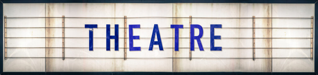 """Marquee sign that says """"Theatre"""""""